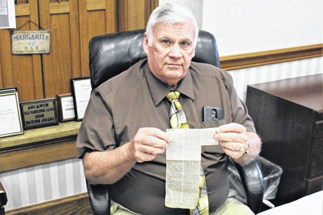 Darke County Commissioner Mike Stegall, a former OHSAA football official holds an article he wrote that was printed in the Advocate upon his retirement from officiating in 2006.