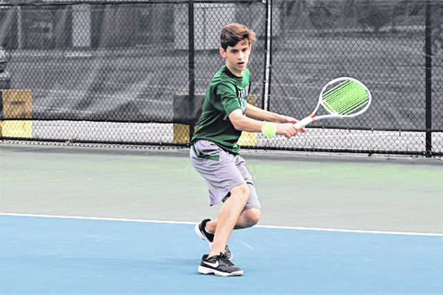 <strong>Greenville freshman first singles, Jack Marchal returns a shot in Greenville win over CJ.</strong>