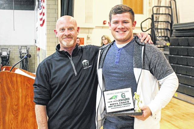 Addison Ernst receives the GHS boys track and field Most Valuable Thrower award.