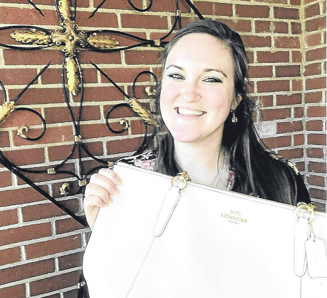 Amber Karns was the grand prize winner of the Coach Purse.