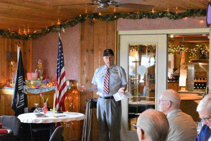 Dave Miller representing the Versailles VFW Post #3849 conducted a memorial ceremony of the missing man table.
