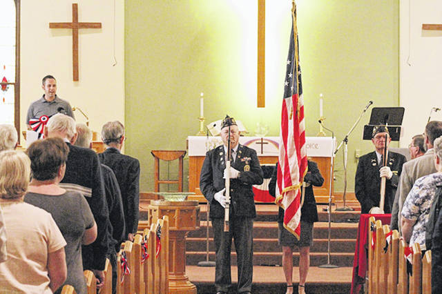 American Legion Post 140's Color Guard presented the colors while John Whirledge led the National Anthem.