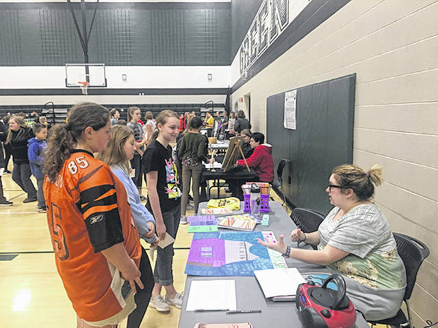 Provided photo Kari Lemon, GMS Theater Workshop advisor, speaks to students on the many opportunities in the program, from set building to making costumes, even publicity, during the first Extra-Curricular Fair held at the Greenville Middle School on Monday.