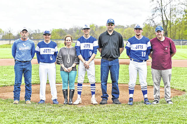 Franklin Monroe senior baseball team members (L-R), Ethan Coppes, Larkin Ressler and Timothy Lawson are honored  before defeating the Bethel Bees.