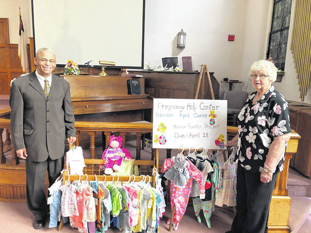 ARCANUM – Arcanum Faith United Methodist Church, 101 E. South St., showed support for the Darke County Pregnancy Help Center during April. Adorable outfits were purchased in newborn to toddler sizes for the Center's clients just in time for celebrating the newness of spring and the glory of Easter. Arcanum Faith UM is a mission minded church. The church is led by Rev. Dr. Gregory Herndon, who invites you to attend Adult Sunday School at 9 a.m. and Worship Service at 10 a.m. Pastor Herndon is shown with Mrs. Shirley Winger, past board member of DCPH.