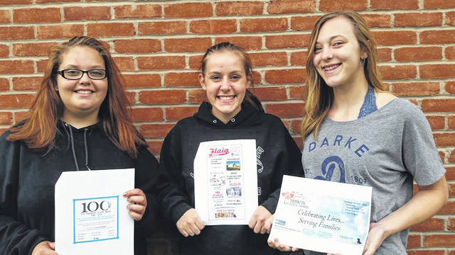 Greenville CTC marketing students, left to right, Makayla Murphy, Rachel Unger and Mikayla Miller hold advertisements they designed for area businesses for the Daily Advocate's Design An Ad project.