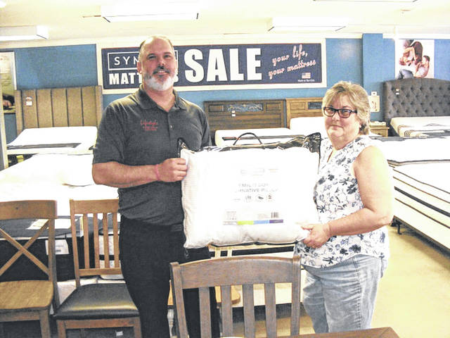 Day 1 Daily Advocate Mother's Day Sweepstakes winner Patty Bunger, right, with Neil Francis/ Prize: Premium Sleep Pillow