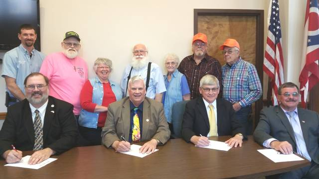 Signing the Farm Power of the Past proclamation were, front row, left to right, Darke County Commissioners Matt Aultman, Mike Stegall and Mike Rhoades, along with Greenville Mayor Steve Willman. Back row, left to right, Farm Power of the Past representatives Chet Linebaugh, Duane Edwards, Nancy Linebaugh, Von Oswalt, Barb Young, Willie Young, and Don Marchal.