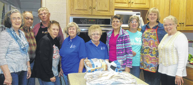 Shown in front of the new double wall oven in the soup kitchen at Grace Resurrection Community Center are, from left to right, Darlene Huffman, soup kitchen coordinator, and St. John Lutheran Church members Darrell Trittschuh, Gary Rismiller, Judy Trittschuh, Donna Howdieshell, Elaine Roan, Mary Jane Dietrich, Rita Rismiller, Carol Bruss and Bonnie Tryon. Also working but not shown is Darrel Roan.