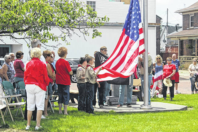 Bethany J. Royer-DeLong Boy Scout Troop 186 conducting a presentation of colors as Arcanum residents paid respect to area veterans during a military banner dedication at the Veterans Memorial Park outside the Arcanum Wayne Trail Historical Society on Monday.
