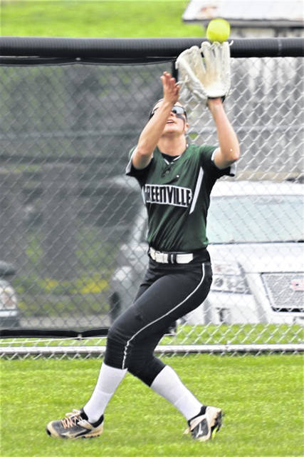 Greenville's lone senior, Lani Shilt makes a catch in right field on senior night for the Lady Wave in GWOC win over Sidney.