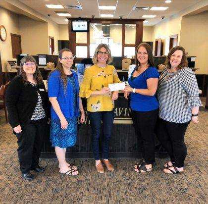 The House that Lulu Built's Camilynn Snyder (center) is shown with Connie Germann, Sheryl Hatfield, Shawna Stewart, and Krista Hines, all from Mercer Savings Bank's Greenville Office.