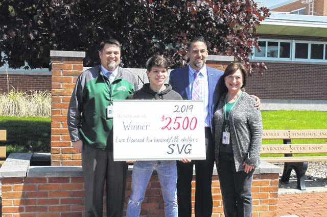 Justin Mullins accepted the check for $2,500 from Steve VanGorder. Mullins was the grand prize winner at After Prom. Also pictured are Principal Stan Hughes and Kathy Quinn, senior class adviser.