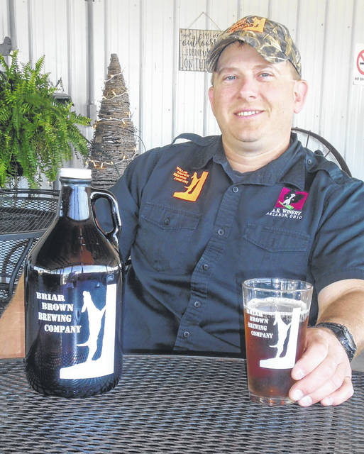 Russell Rex, owner of Briar Brown Brewing Company and A.R. Winery, takes a break and relaxes with a cold glass of Darke County Pilz, which he unveiled to the public recently. He and wife Angie own the business on Gordon-Landis Road.
