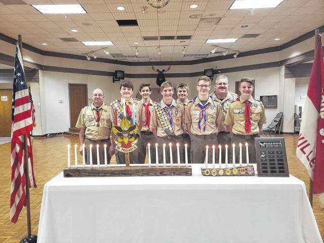 Front row, left to right, Graham Milligan, new Eagle Scout James Normile, Mason Garber, and Blake Addis. Back row, left to right, Rick Normile, Jack Marchal, Grant Read, and Ken Livingston.