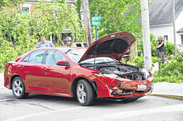 A Tuesday evening crash in New Madison resulted in three people being transported to Wayne HealthCare.