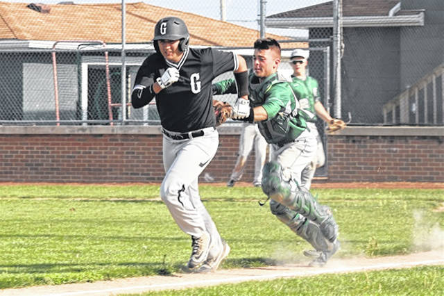 Greenville senior cathcer Ethan Saylor gets the tag for an out in a rundown between home and third in Wednesday night game with Graham.