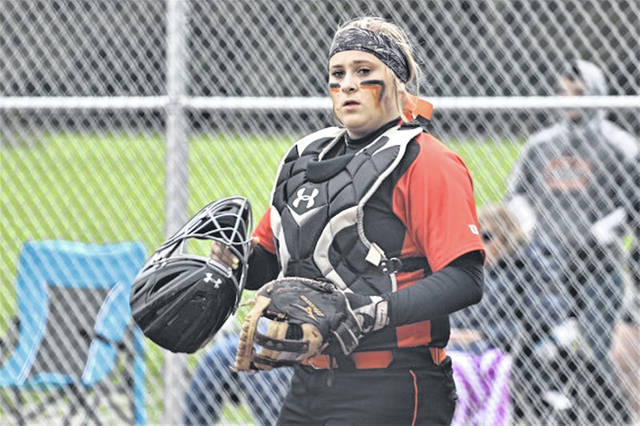 Arcanum senior Kaylee Wilcox catchers her final game for the Lady Trohans in the team's touranment game against West Liberty-Salem.