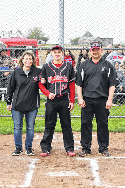 Kyler Guillozet is honored along with his parents on senior night at Mississinawa Valley baseball game.