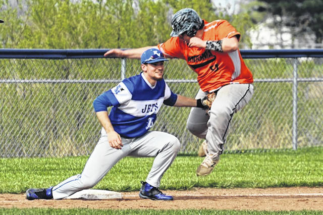 FM's Tim Lawson tags Ansonia's Caleb Jones on an attempted steal of third.