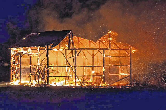 Fire crews battled a fully engulfed barn fire on State Route 47 near Ansonia early Wednesday morning.