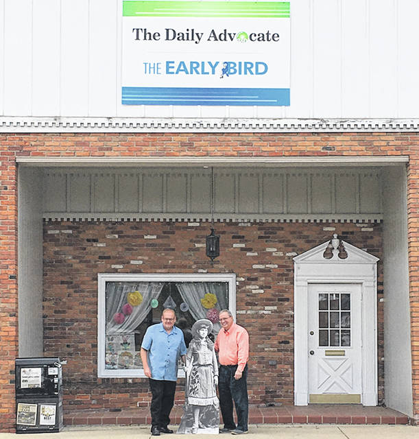 Ryan Berry, editor, and Keith Foutz, publisher, of the Early Bird and Daily Advocate are shown with Annie.