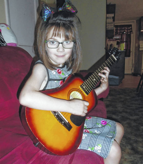 Kaytei Auske enjoys playing the guitar and singing to her family and friends. She will be undergoing open heart surgery on June 6.