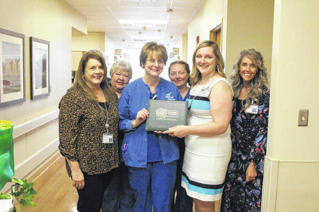 Irene Wirrig received her Daisy Award from Kim Freeman, vice president of patient care services.