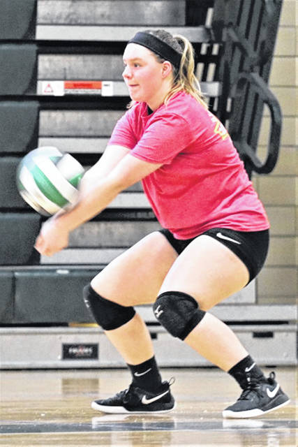 Greenville gets a return from a high school camper at the school's volleyball camp.