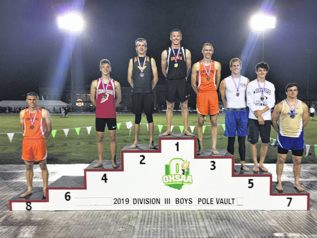 Ansonia junior Brock Shellhaas stands atop the OHSAA Division III boys pole vault podium with 2019 State Championship.