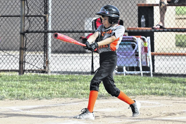 A young Arcanum baseball player takes his cuts at the Tim Todd Memorial.