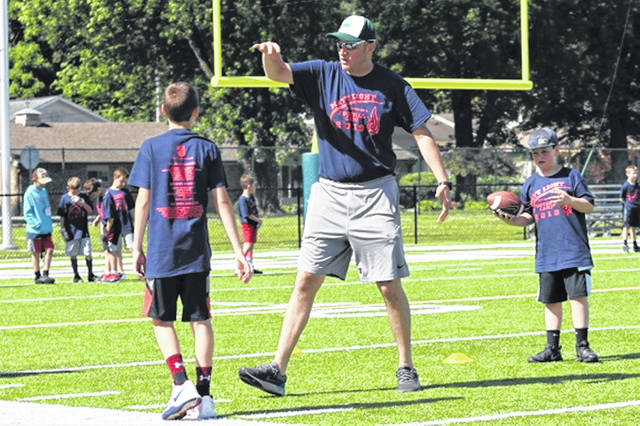 Greenville head varsity football coach Bart Schmitz gives instructions to campers at the recent Matt Light All-Conference Football Camp.