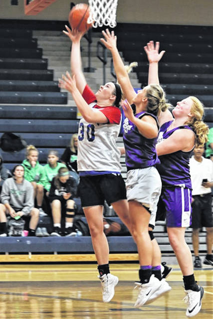 Tri-Village Lady Patriots Maddie Downing scores for in the paint in the teams weekend Lady Patriots Summer Shootout.