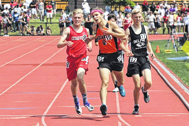 Arcanum-Butler senior Tanner Delk crosses the finish line to earn a fourth place finish in the OHSAA D-III 3200 meter state finals.