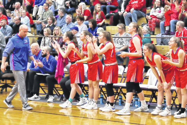 Tri-Village Lady Patriots coach Brad Gray patrols the sidelines in the team's 2018 Sweet Sixteen Regional game against the eventual State Champion Minster Lady Wildcats.