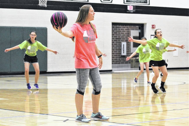 Lady Wave varsity girls basketball coach Rachel Kerns gives instructions to campers at the 2018 Lady Wave Basketball Camp.