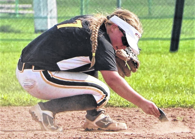 LWSB incoming senior Morgan Gilbert makes her patented base cleaning between innings of an Ohio Hawks Wagner softball tournament game.
