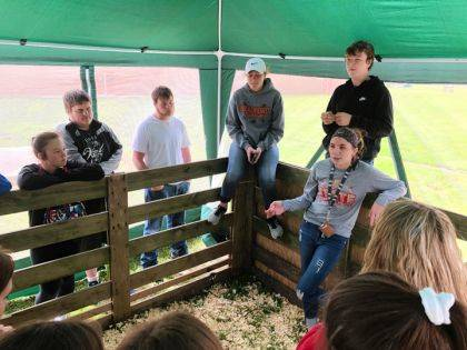 Alexis Barhorst educates high school students about dairy cattle and the dairy industry.