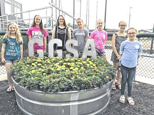 "The Butterflies Junior Garden Club have planted their annual civic planting at the Greenville Girls Softball Association, Stebbins field. The club planted Taishan, Janie and Durango Bee marigolds. Added was the galvanized letters GGSA to the stock tank. They planted two 36"" fire rings with the same varieties of marigolds and two galvanized trash cans with cannas, million bells and sun coleus. Members keeping the flower beds watered for the summer are left to right, Maleah Hines, Brianna Fellers, Hannah Smith, Saige Fellers, Audrey Allread, Callee Moore and Ellie Grosch."