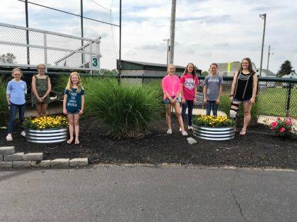 "GREENVILLE – The Butterflies Junior Garden Club added two 36"" fire rings to the landscape of the flower plantings at the Greenville Girls Softball Association at Stebbins Field on State Route 49 North. Support for the project came from the Ladybug Garden Club and the Michael Beard Fund Support which was presented to the club from the Beard family. Shown are Butterflies members Ellie Grosch, Callee Moore, Maleah Hines, Audrey Allread, Brianna Fellers, Saige Fellers and Hannah Smith."