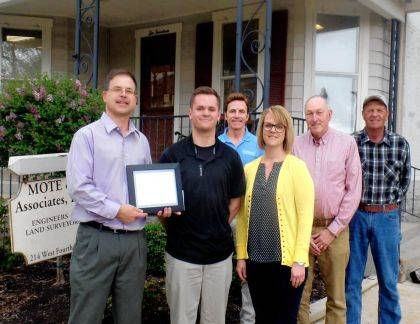 Clayton Pearson received a scholarship from Mote & Assoc. Shown are (front row) Michael Bruns, Clayton Pearson, Beth Pearson, (back row) Jerry McClannan, Michael Henderson, and Louis Bergman.