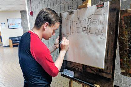 Dalton Wolf works on a 3-dimmensional perspective drawing during art class at Edison State.
