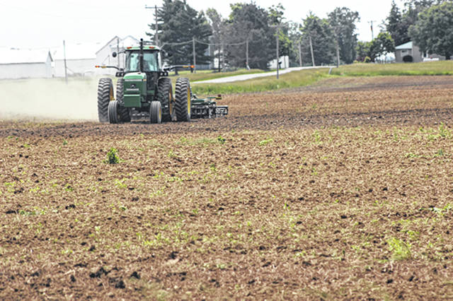 Wet weather has taken a toll on area farmers, delaying corn and soybean planting. However, county farmers took advantage of the dry weather on Tuesday, including this farmer on State Route 49, north of Greenville.