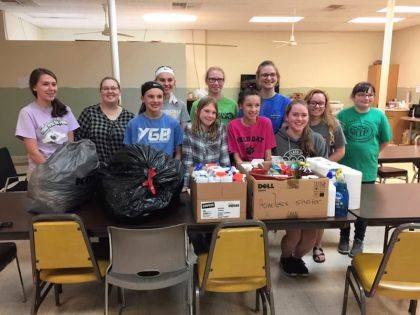 Members of Hands Across the Darke are pictured with items that were donated by the community for use at the Darke County Homeless Shelter.