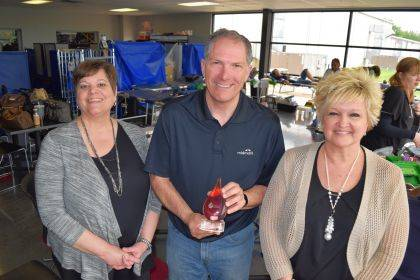 CBC's Dana Puterbaugh presented the CBC community service award to Midmark Global Philanthropic & Corporate Giving Manager Mitch Eiting and Media & Communications Manager Susan Kaiser at Midmark's May 16 employee blood drive.