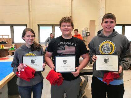 FFA members Kennedy Hughes, Caleb Smith, and Clay Bergman named Versailles FFA Members of the Month.