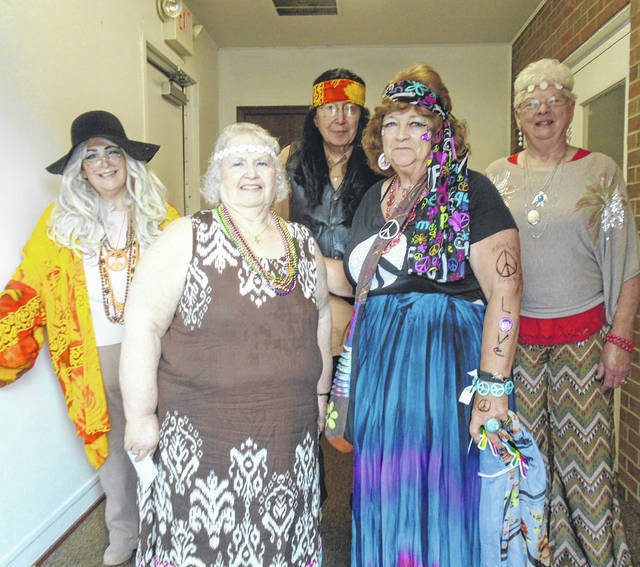 Costume winners at the hippies' dance at the VFW Hall in Greenville during the weekly senior dance were (front row from left to right) Barbara Bey, first, and Linda Griffis, second; and, standing, Tamm Eichler and husband Jerry for third and fourth; and Diane Resor, the fifth-place winner. Tom Everhart is the deejay for these dances and, in addition to playing the hippy era music on Monday, he, exchanged trivia information with the audience. Fifty people attended this week's dance.