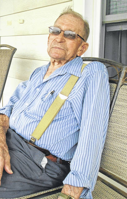 Bob Lee sits on his front porch on Monday, the day before he turned 93, and reflected on his time in the military and life in general.
