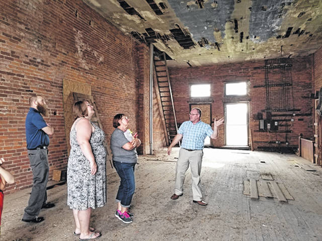 Bethany J. Royer-DeLong/Darke County Media Arcanum Village Administrator, Bill Kessler, shares information with residents regarding the space behind the former VFW rooms on the second floor of the former village hall during a planning committee meeting on Thursday.