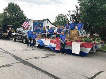 Versailles FFA members who participated in the FFA float during Poultry Days were (back row) Lauren Sherman, Cayla Batten, Sara Cavin, Darian Feltz, Tori Wuebker, Luke and Darren Billenstein, (front row) Caden Buschur, Maddy Henry, and Deanna Hesson.